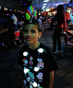 Son 1 with Christmas bulb mohawk and snowflake necklace